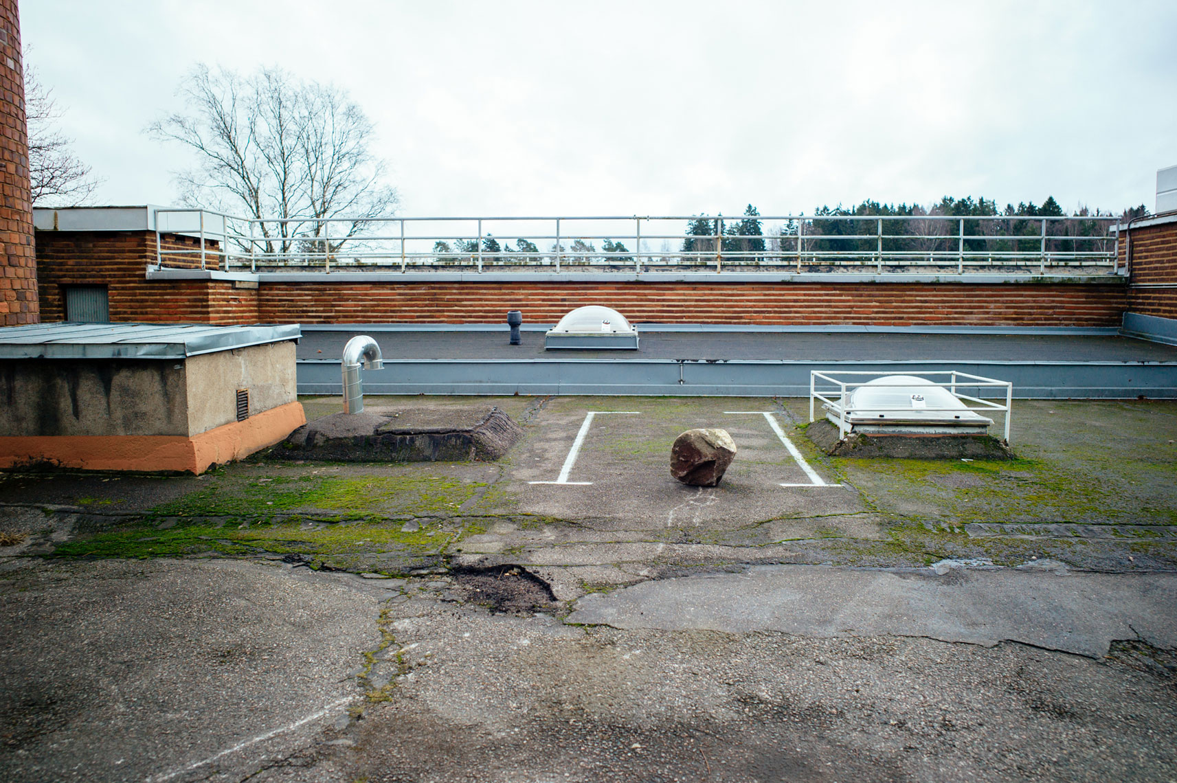 jon pack, photographer | the olympic city | helsinki, finland | parking spot | rock | village